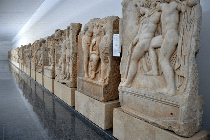 Original reliefs are presented in a nearby museum