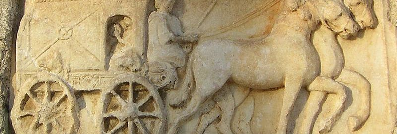 Roman relief showing a cart drawn by four horses