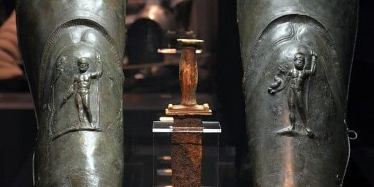A dagger with a pair of gladiator greaves