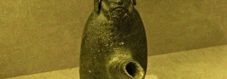 Roman lamp depicting the Gallic deity Cucullatus