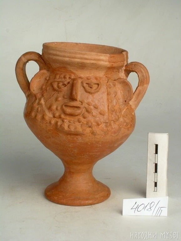Roman vessel with face image