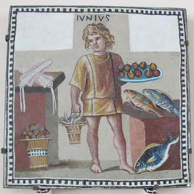 Mosaic plate showing a boy holding a plate of fruit
