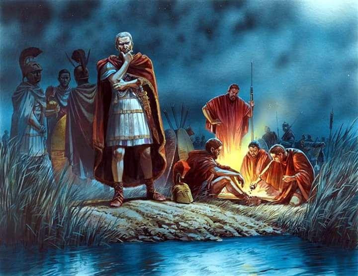 Grafika ukazująca rozmyślającego Cezara przed przekroczeniem Rubikonu