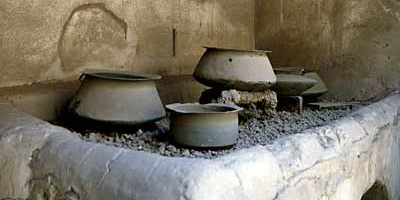 Roman kitchen with utensils in House of Vettii