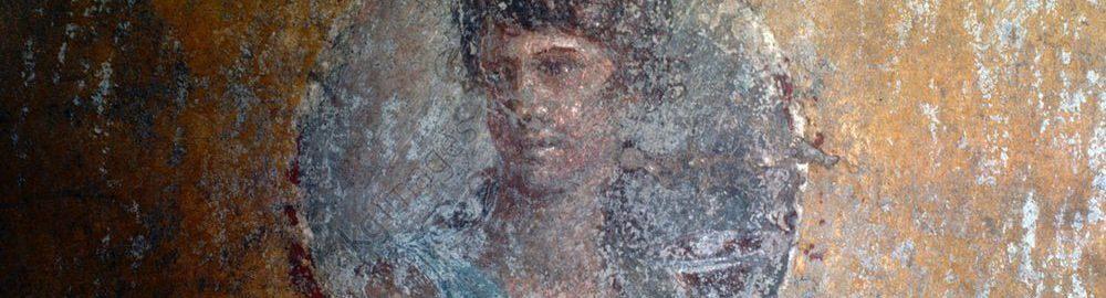 Portret młodej kobiety na ścianie w Pompejach