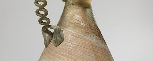 A glass Roman vessel with a chain handle. Object dated to the 3rd century  CE