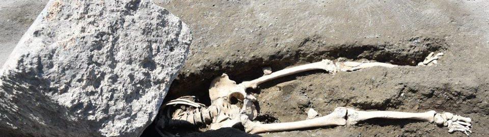 Roman skeleton pinned down by stone
