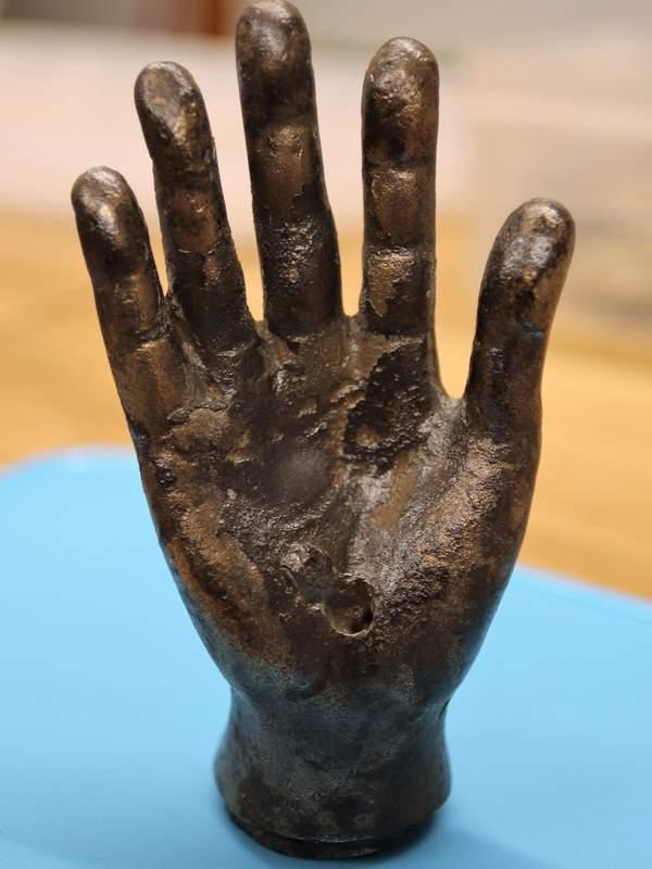 A bare bronze arm in the Roman camp of Vindolanda