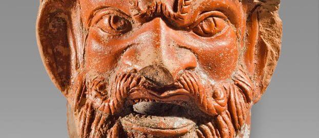 Roman lamp showing a grotesque face