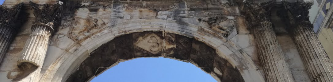 Attic of the triumphal arch in Pula with visible bases of statues
