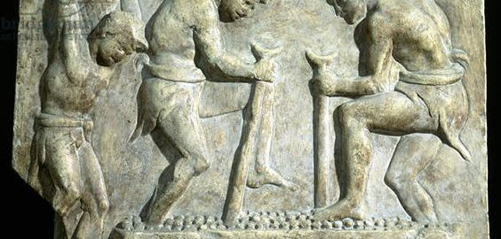 Relief showing the squeezing of grape juice