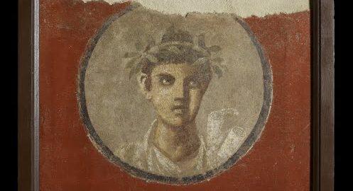 Pompejańczyk trzymający zwoje