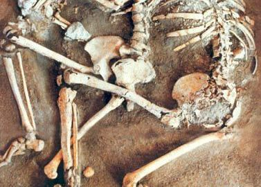 Skeletons of a family protecting themselves from an earthquake