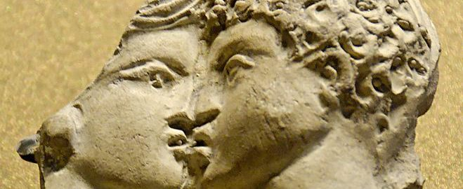 Roman clay fragment with relief decoration depicting a couple kissing.