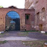Courtyard in front of the church of Santa Maria Antiqua in Forum Romanum. A rectangular brick footprint on the ground in front of the church marks the outline of the former basin in the courtyard of the Caligula's Palace.