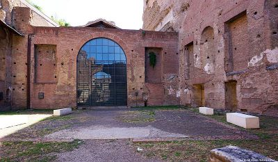 Courtyard in front of the Church of Santa Maria Antiqua by the Forum  Romanum. A rectangular brick mark on the ground in front of the church marks  the outline of the former basin in the courtyard of Caligula's palace.