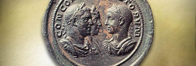 Roman coin with three imperial images