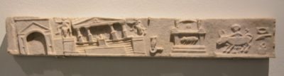 Relief from the lararium in the house of Lucius Cecilius Jukundus, which  is believed to show the destruction of the city's public buildings as a  result of the earthquake