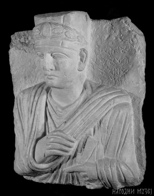 Roman tombstone with portrait of priest
