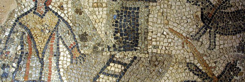 A man with a rooster's head on a mosaic