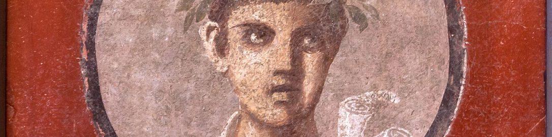 Fresk z Pompejów ukazujący młodego człowieka ze zwojami