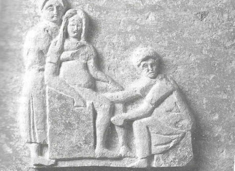 Childbirth of a Roman woman on a bas-relief