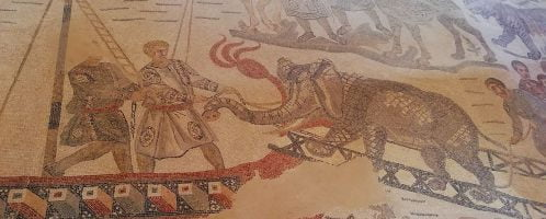 Roman mosaic showing scene of elephant being brought aboard ship